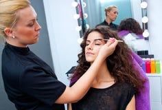 Woman putting mascara make up Royalty Free Stock Photos
