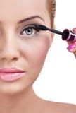 Woman putting mascara makeup. Royalty Free Stock Image
