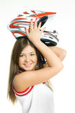 Woman putting on a motorcycle helmet Stock Image