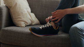 Woman putting on new sneakers running shoes stock video footage