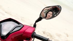 Woman putting off Helmet - reflection in a mirror stock video