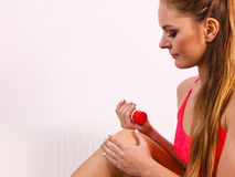 Woman putting ointment on injury knee skin care Royalty Free Stock Photo