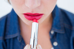 Woman putting red lipstick Royalty Free Stock Photos