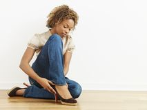 Woman putting on shoes Stock Photography