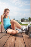 Woman putting on skates going rollerblading Royalty Free Stock Photo