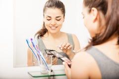 Woman putting some makeup on Stock Image