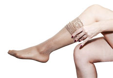 Woman putting on stockings Royalty Free Stock Photo