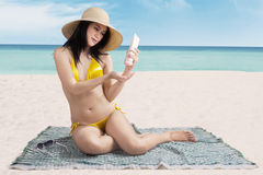 Woman putting sunblock Royalty Free Stock Photo