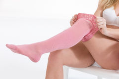 Woman putting thrombosis stockings on Stock Image