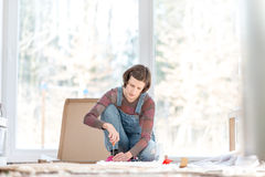 Woman putting togehther home furniture Royalty Free Stock Photo