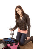 Woman putting weights in luggage Royalty Free Stock Image