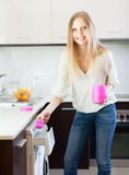 Woman putting whitener in to washing machine Royalty Free Stock Photography