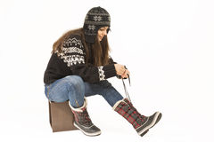 Woman putting on winter shoes. Stock Photos