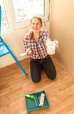Woman with putty, spatula and paint roller Stock Photography