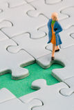 Woman puzzle. Woman in front of a missing jigsaw piece Stock Photo