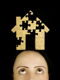 Woman with a puzzle to solve Stock Photo