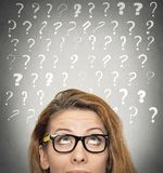Woman with puzzled face expression and question marks above head royalty free illustration