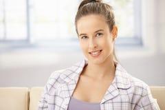 Woman in pyjama on sofa Royalty Free Stock Image