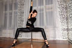 Woman pylon poldans studio Stock Images