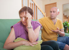 Woman quarrel with his son. Adult son and elderly mother during  quarrel  at home Royalty Free Stock Photography
