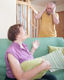 Woman quarrel with his son. Quarrel between an elderly mother and adult son Stock Image