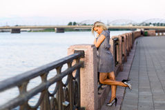 Woman on a quay. Royalty Free Stock Image