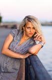 Woman  on a quay. Stock Photos