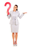 Woman question mark. Confused woman holding question mark on white background Stock Images