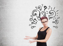 Woman and question mark wall Royalty Free Stock Images