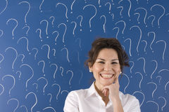 Woman with question marks Royalty Free Stock Images