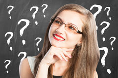 Woman and question marks arround her Royalty Free Stock Photography