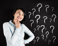 Woman and question marks Royalty Free Stock Photography