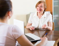 Woman questionnaire for  social worker. Smiling mature women questionnaire for  adult social worker Stock Image