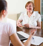 Woman questionnaire for social worker. Smiling mature women questionnaire for  happy social worker Royalty Free Stock Photo