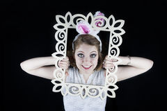 Woman with rabbit ears and frame Royalty Free Stock Photography