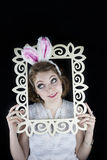 Woman with rabbit ears and frame Stock Photography