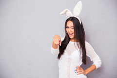 Woman in rabbit ears pointing finger at camera Royalty Free Stock Images