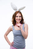 Woman in rabbit ears showing finger over lips Royalty Free Stock Image