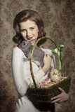 Woman with rabbit and easter eggs Stock Image