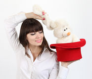 Woman with rabbit in top hat Stock Images