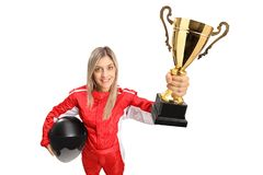 Woman racer in a suit holding a gold trophy cup. Isolated on white background royalty free stock photos