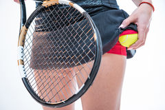 Woman with racket and ball Stock Photo