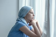 Woman after radiation therapy. Woman with cancer after radiation therapy in hospital royalty free stock photo