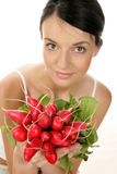 Woman with radishes Royalty Free Stock Photography