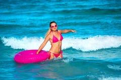 Woman with raft. On the tropical beach stock photos