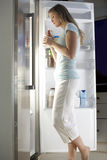 Woman Raiding The Fridge At Night stock photo