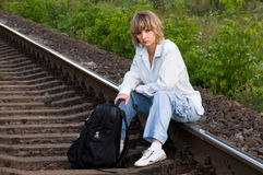 Woman and railroad. Beautiful young woman waiting for the train Stock Images