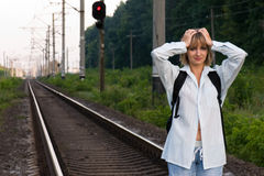 Woman and railroad. The beautiful young woman, was late for a train Stock Photography