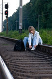Woman and railroad. The beautiful young woman, sits on the railway Royalty Free Stock Photography