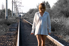 Woman and railroad. Young beautiful woman walking on a railroad track Stock Photography